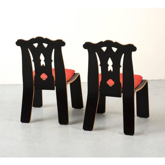 A pair of Postmodern chairs by Robert Venturi in black laminate and plywood with original red wool upholstery for Knoll,...