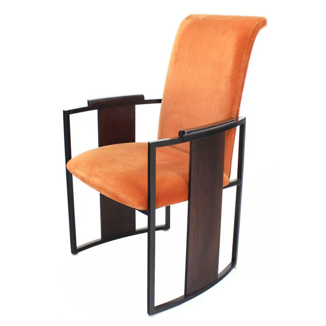 Set of six rosewood and metal frame dining chairs.
