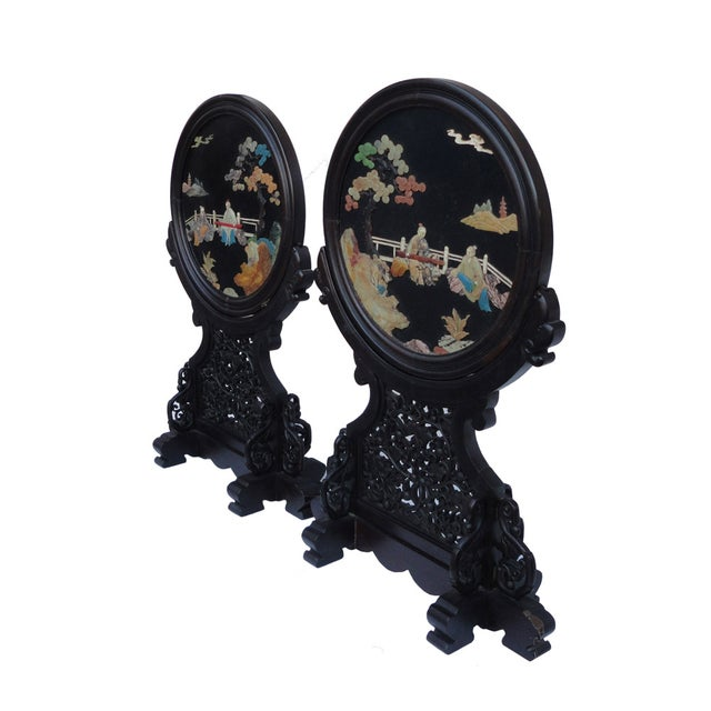 Handmade, traditional oriental-style, tabletop plaques featuring a round, medallion shape and decorative bases. The center...