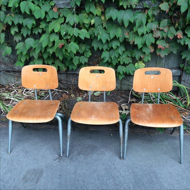 This is a set of 3 wood seat and back chairs. The wood is plywood and the legs are gray painted metal. Each chair measures...