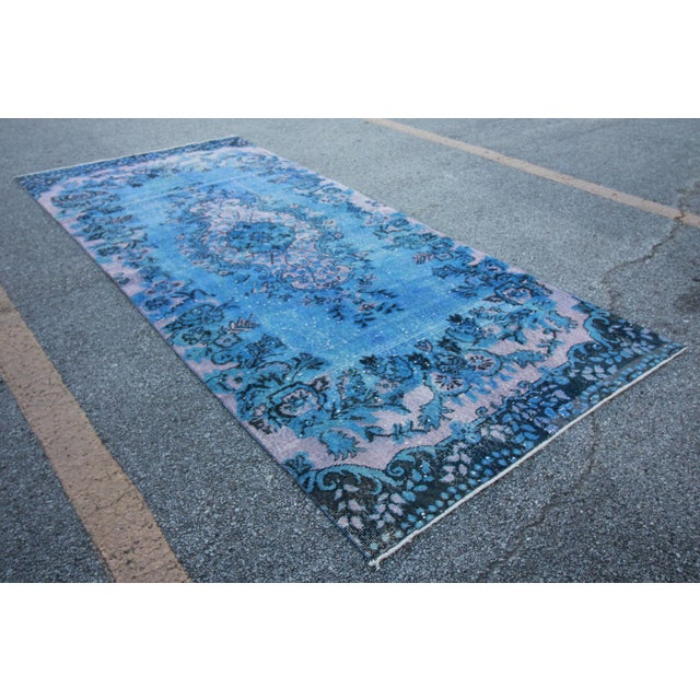 This is a distressed vintage Turkish royal blue overdyed area rug. These types of Turkish vintage rugs are from the...