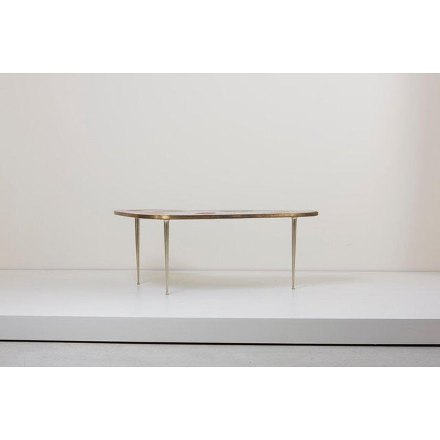Beautiful version of a Berthold Muller Mosaic coffee table with rare colors and very nice brass legs and frame.