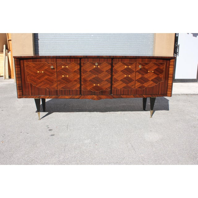 Long French art deco 5 doors exotic macassar ebony mother of pearl sideboard/buffet/bar, circa 1940s. The sideboard are in...