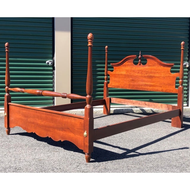 A traditional cherry four post pineapple top queen or full size bed frame. Set includes headboard, footboard, and side rails.