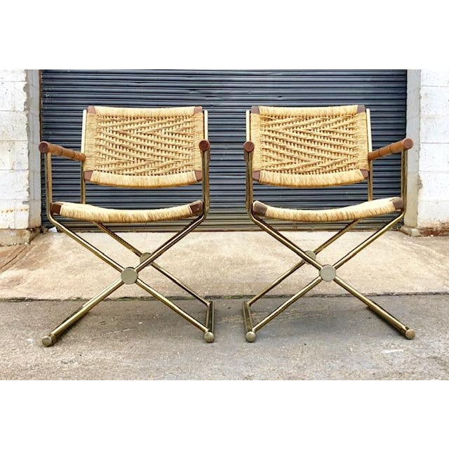 Pair of stylish Mid Century Modern, Directors style arm chairs. Rush seat and back having a unique Zig Zag pattern. Bamboo...