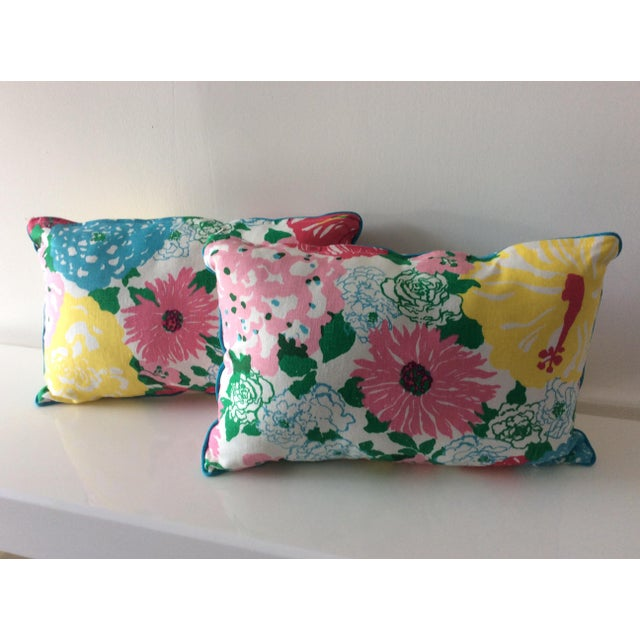 "Pair of handmade pillows created with Lilly Pulitzer fabric by Lee Jofa. Blue welting around border of pillows. 20"" x 14""..."