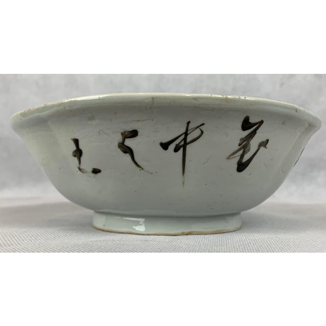 Vintage hand decorated Chinese porcelain bowl painted with flowers, leaves and a bird. On the reverse there is a poem. Use...