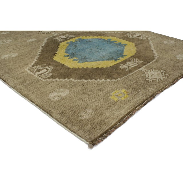 Add personality to your space with a modern take on eclectic style. This vintage Turkish Oushak rug with modern...