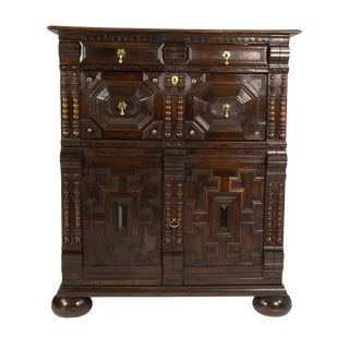 Anglo-Dutch Oak Moulded Front Two-Part Chest With Geometric Applied Mouldings and Ebonized Panels For Sale