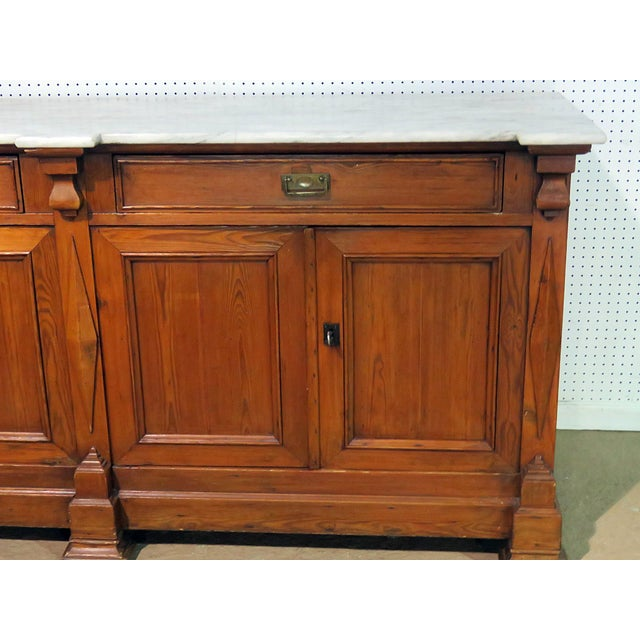 Continental style marble top sideboard with 2 drawers over 4 doors containing one shelf.