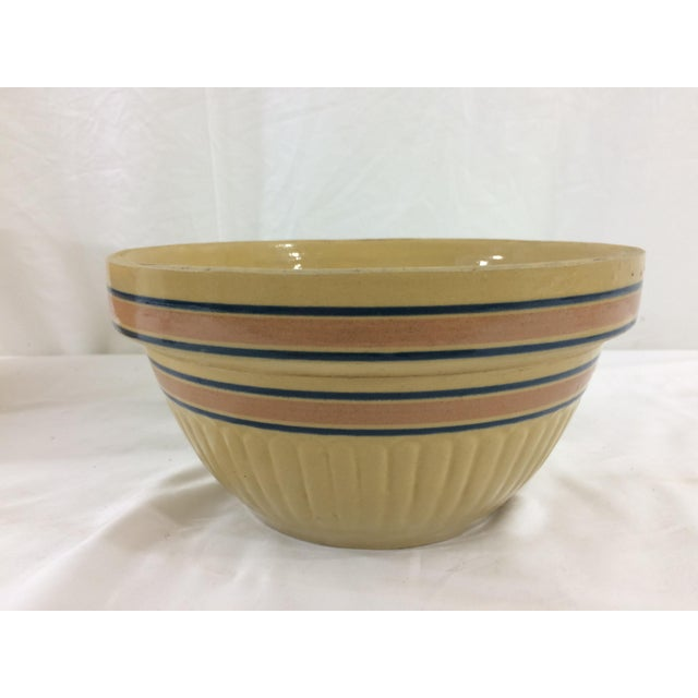 This is a wonderful example of functional Weller Pottery with gorgeous fluting and black and brick red stripes. In good...