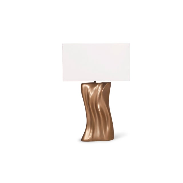 """Doris Table lamp available in different finishes. The Shade is ivory white silk. Base:9 ½"""" L x 5 ½"""" W x 18"""" H Shade: 18"""" x..."""