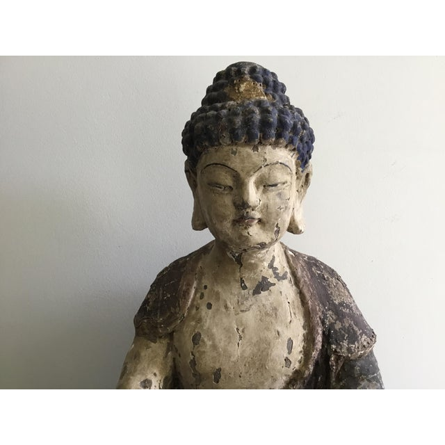 Beautiful Buddha carved in wood and coated with gesso and paint. We believe it is early 20th century. The details are...