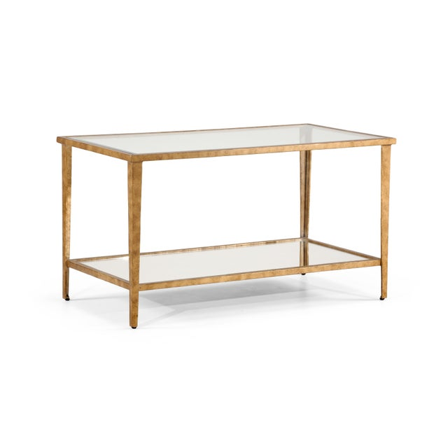 This is the Carson coffee table by Chelsea House Inc. The piece features an antique gold leaf finish on iron, a glass top,...