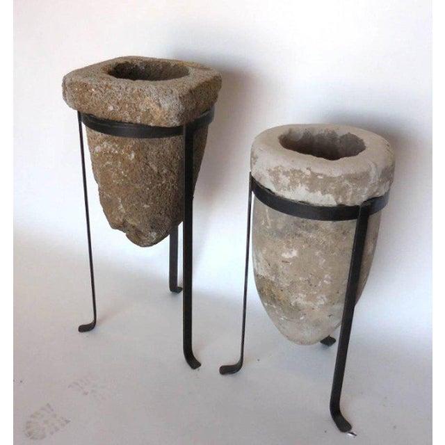 Two antique stone water filters, sold separately, on custom hand forged iron bases. Looks great with or without a plant!...