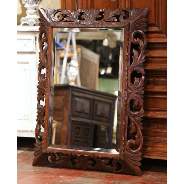 Crafted in France circa 1880, and built of oak wood, the antique mirror is rectangular in shape and could be hang...