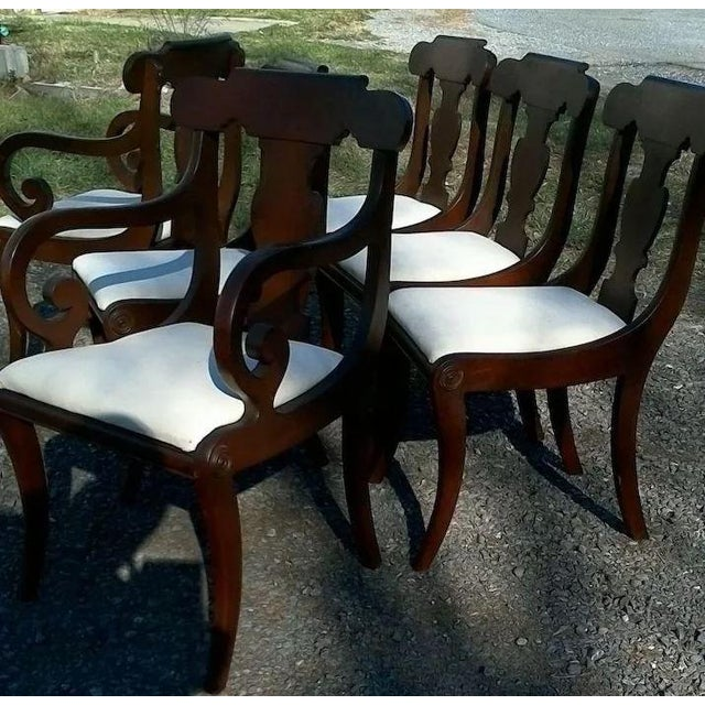 This is a very nice set of six Regency Dining Chairs, two arm chairs and four side. The scrolled arms look so elegant and...