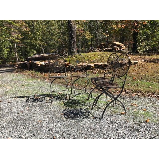 Art Deco vintage pinwheel folding outside patio chairs. Unrestored and so original wrought iron. Elegant design Pinwheel...