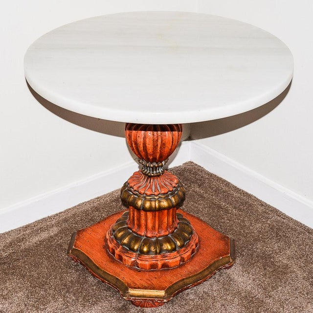 An Italian Regency inspired 1940's era pedestal side table with a detached white marble top. The fluted architectural...