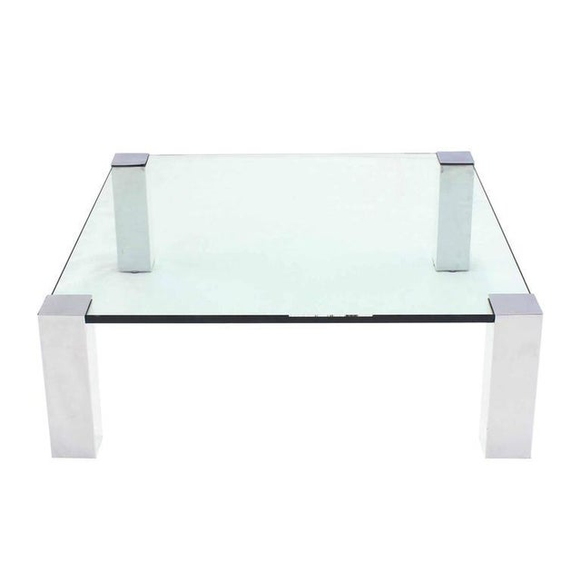 Very nice square coffee table with thick glass top and chrome legs. Measures: 41 x 41.