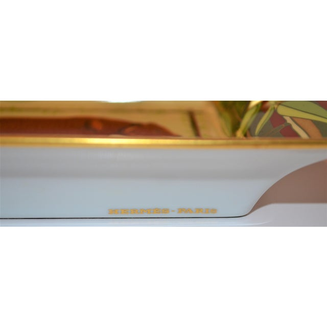 This is a vintage Hermes porcelain cigar tray circa 1970's. This tray features a brown golden bear with a bamboo and gold...