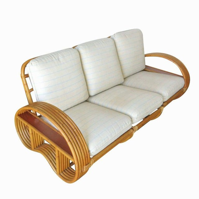 As Seen On The Cover Of Architectural Digest September 2019 A full rattan living room set featuring a three-seat sofa with...