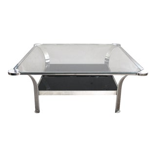 A Large-Scaled and Shapely French 1970's Steel Square-Form Coffee Table With Clear Glass Top and Black Glass Lower Shelf For Sale