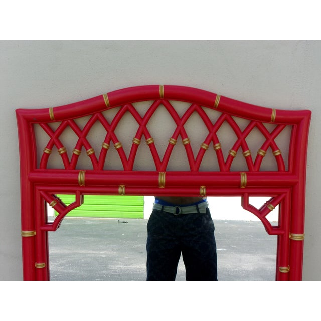 Vintage bamboo style mirror with fretwork details and gold painted accents Newly painted in a beautiful satin coral red...