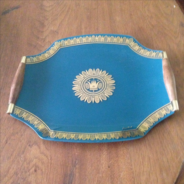 A vintage glass Georges Briard serving tray. This piece features peacock blue glass with gold border & gold medallion,...
