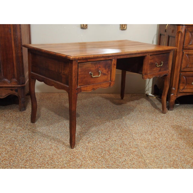 Beautiful rectangular desk with two deep drawers and cabriole legs. The top is made of pine and the bottom is oak. Brass...