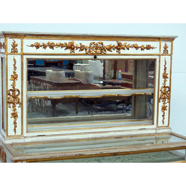Antique Venetian distressed painted display case with gilt accents.