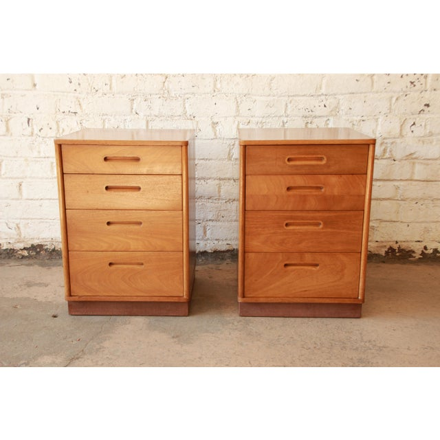 Offering an exceptional pair of mid-century modern mahogany nightstands designed by Edward Wormley for Dunbar Furniture....