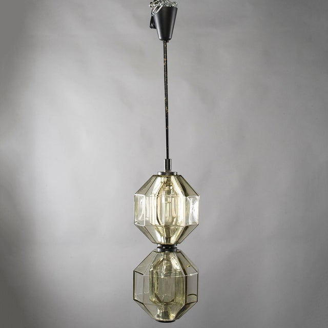 Circa 1960s Vistosi pendant or lantern fixture consists of double hand blown glass paneled vessel in pale amber with black...