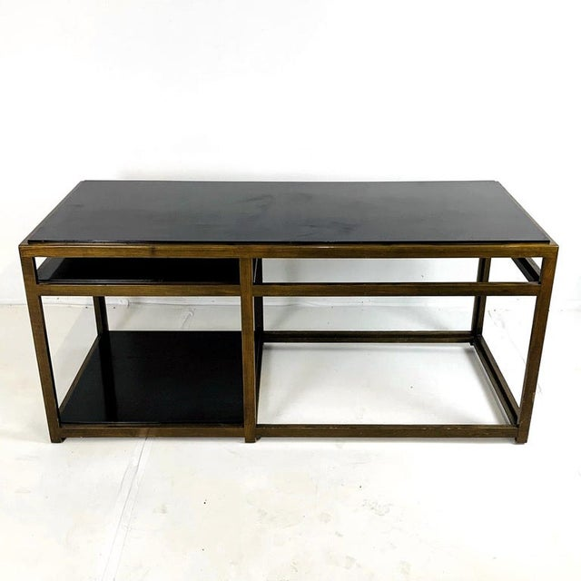 Dunbar Architectural table No. 5403 in a darkened ash with black laminate top and shelves designed by Edward Wormley. Very...