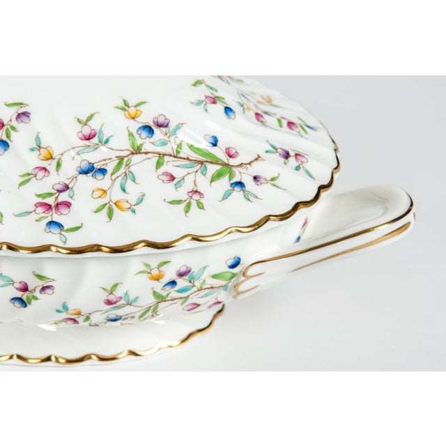 Minton English porcelain full service dinnerware for twelve people with serving pieces. Each piece is in excellent...