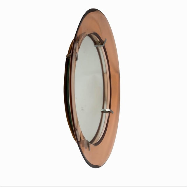 A circular mirror, salmon color crystal glass design by Cristal Art. Made in Italy ca. 1960