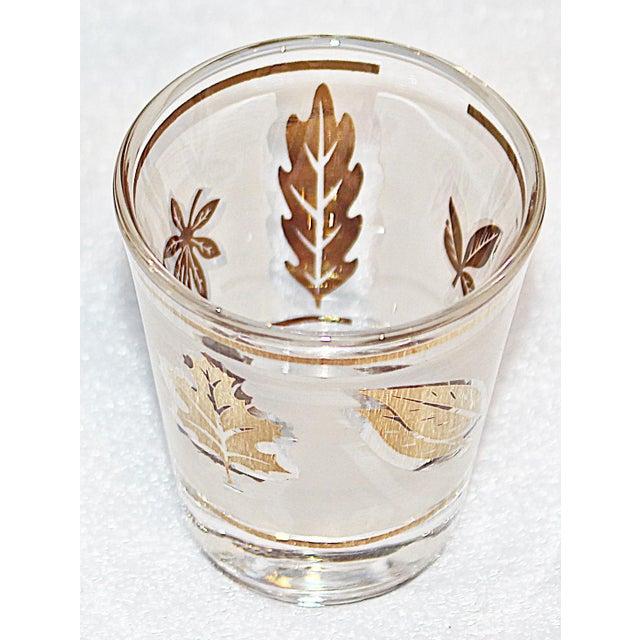 Madmen rejoice with this original 1960s set of gold-leaf patterned shot glasses by Libbey, set of 6.