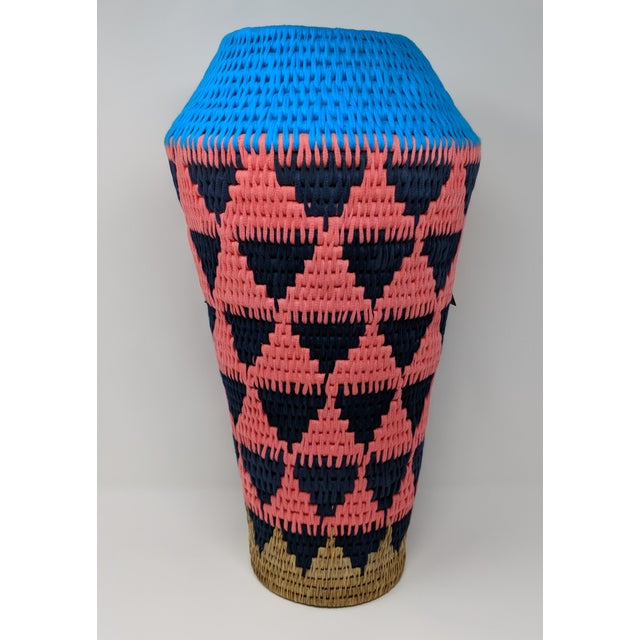This cool boho style vase is hand woven in Swaziland from indigenous and renewable natural fibers and brightly dyed...