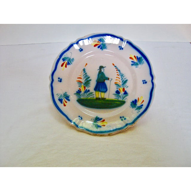 Antique rare Henriot Quimper hand decorated pottery plate adorned with gentleman enjoying the outdoors. Excellent antique...