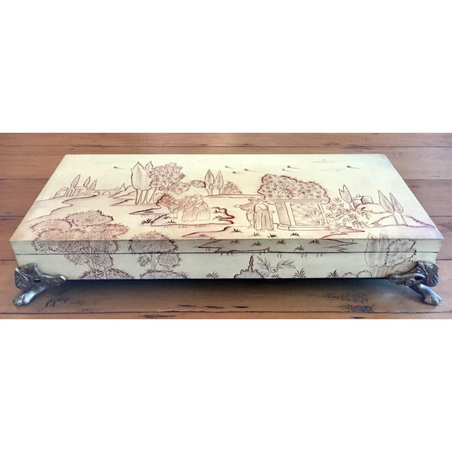 A gorgeous hand painted Chinoiserie style decorative box by Sarreid Ltd.. This large decorative box features a painted,...