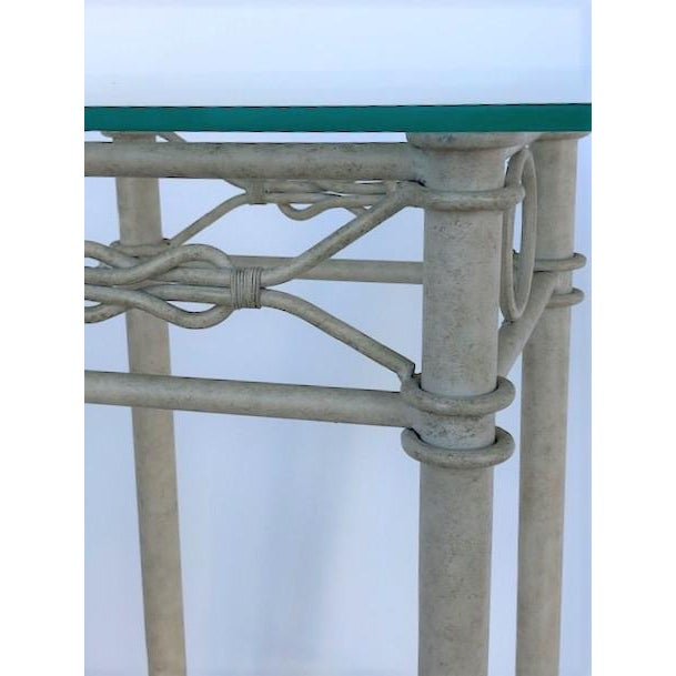 Available for sale: Sculptural metal pedestal base with glass top. IT features great details such us knots and laces.