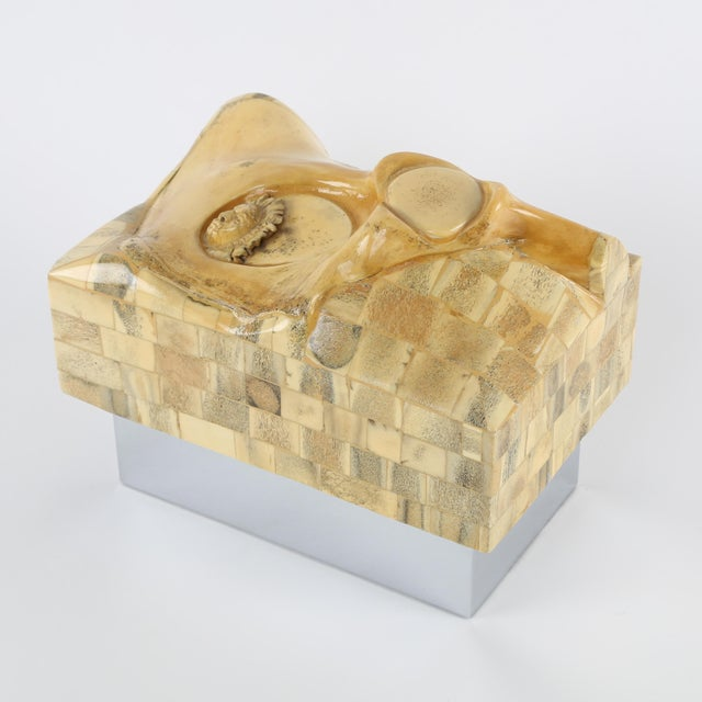 A conversation starter if ever there was one. This rare and unusual 1970s box features a large bone as well as a small...