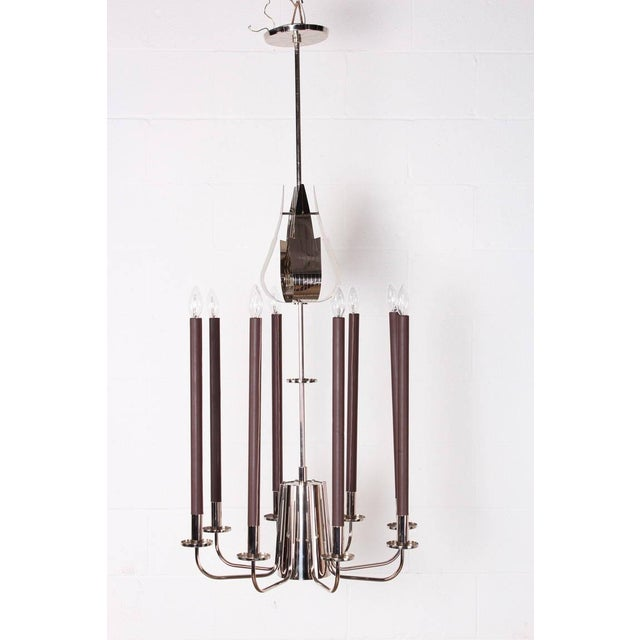 A rare and large design for Parzinger Originals. This model has eight leather wrapped candelabras and a larger down light...