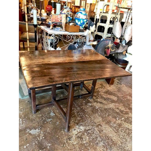 This is a rare English oak and elm single gate leg breakfast table. The table appears to be all original, retaining it's...