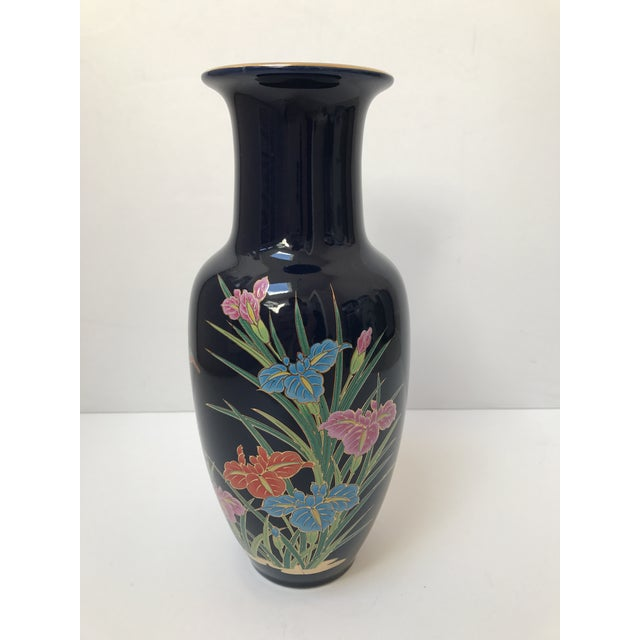 Stunning navy Asian inspired vase with floral and gold motif. The coloring is gorgeous.