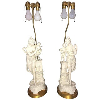 Pair of Large Porcelain Figural Opposing Bare Brested Woman & Angel Table Lamps For Sale
