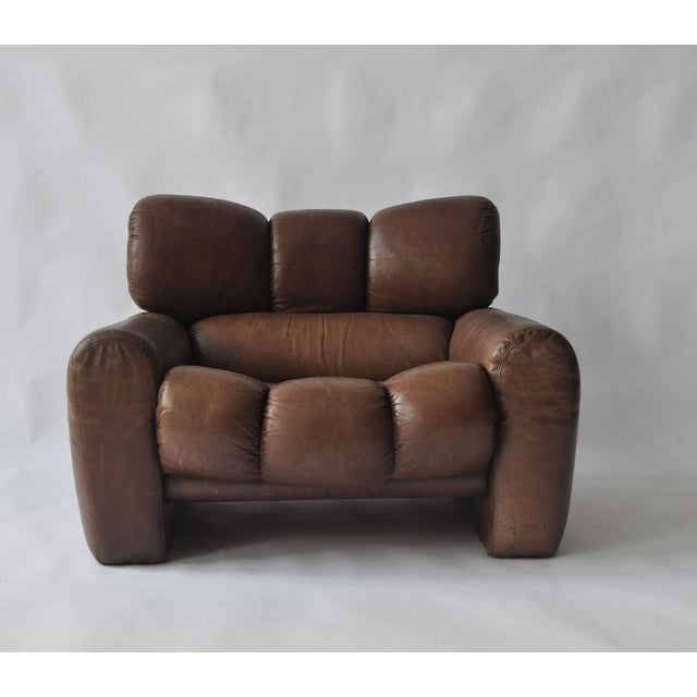 Large-scale 1970s leather lounge chair. Exceptional quality and comfort. Original leather is nicely worn with great patina.