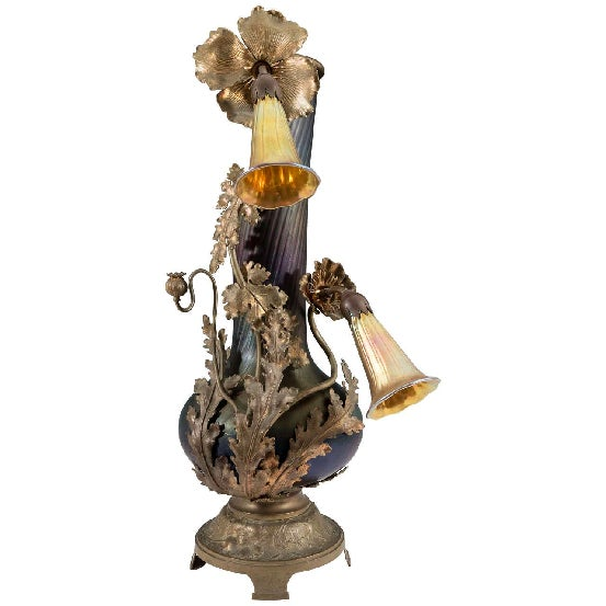 Austrian Art Nouveau table lamp, produced circa 1900s, in the form of a Deep Amethyst Glass Vase on a stylized bronze...