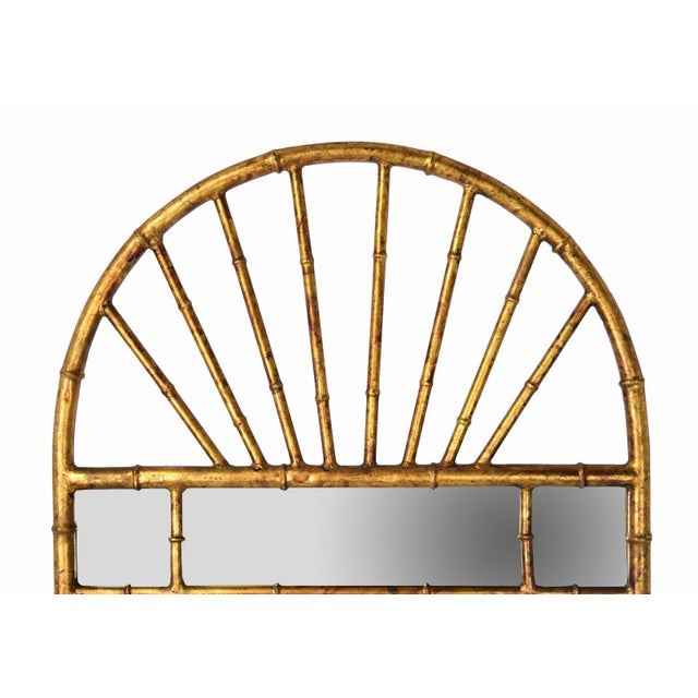 Lovely vintage hand leafed gilt metal faux bamboo wall mirror made in Spain for LaBarge. Circa 1960. Measures 51in height...