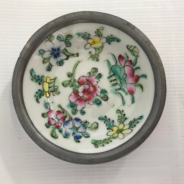 Pair of vintage hand painted Chinese porcelain dishes with pewter clad collars.